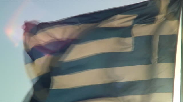 cu greek flag blowing in wind / santorini, greece - greek flag stock videos & royalty-free footage