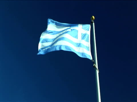 ms, greek flag flapping against clear sky - greek flag stock videos & royalty-free footage