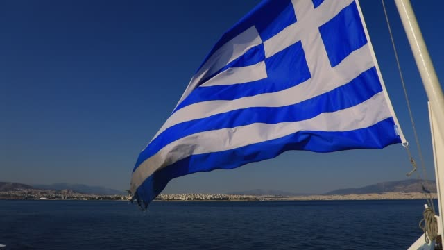 a greek flag float on a ferry deck near athens main harbor piraeus during departure on august 8 2020 in athens greece first port and main industrial... - greek flag stock videos & royalty-free footage