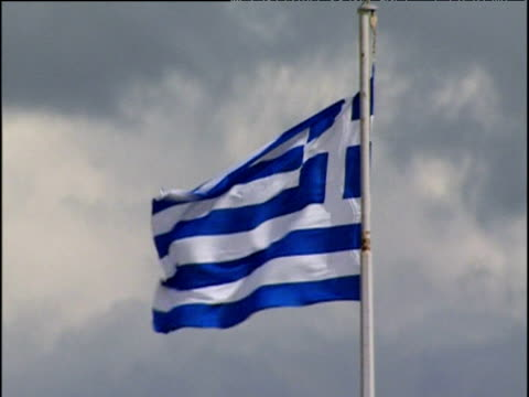 greek flag (galanolefki) fluttering in breeze against cloudy sky - greek flag stock videos & royalty-free footage