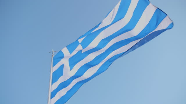 a greek flag flying in greece. - ギリシャ国旗点の映像素材/bロール