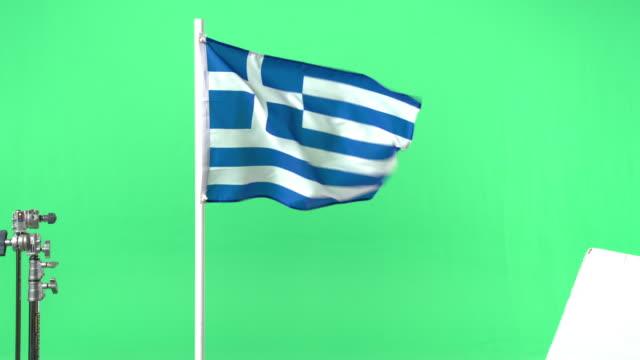 vídeos y material grabado en eventos de stock de greek flag on green screen - bandera griega