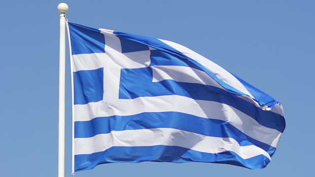 cu slo mo greek flag waving in wind / caen, normandy, france - greek flag stock videos & royalty-free footage
