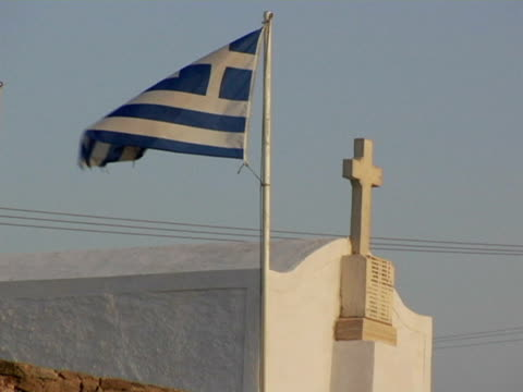 ms, greek flag with small church in background, naxos, greece - greek flag stock videos & royalty-free footage