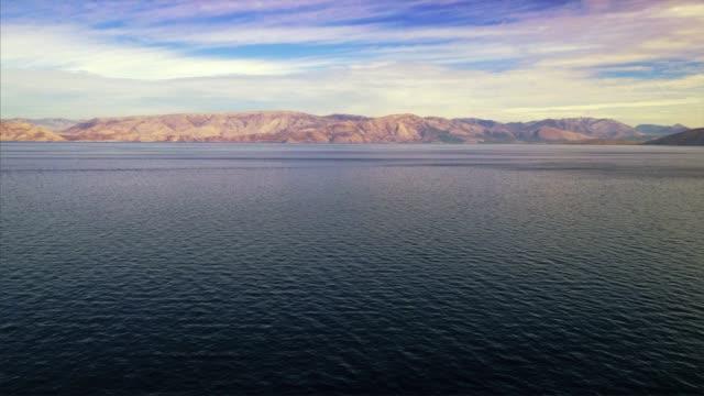 vídeos de stock, filmes e b-roll de greek island of corfu from out in the mediterranean sea, greece - passear sem destino