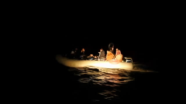 greek military authorities release video that shows greek coast guard turning back dinghy carrying undocumented migrants to greece in the aegean sea... - mittelmeer stock-videos und b-roll-filmmaterial