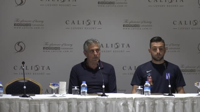 Greek National Football Team head coach Angelos Anastasiadis and his player Efthymios Koulouris attend a press conference on the eve of the...