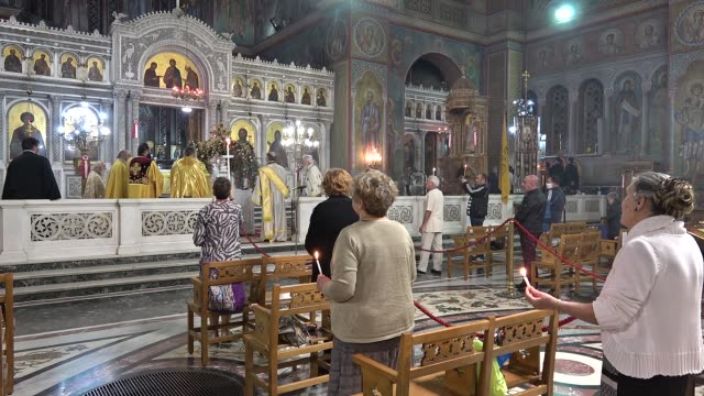 """greek orthodox faithful celebrate the resurrection of christ at midnight, in """"aghios panteleimonas"""" church keeping social distancing on may 26 in... - religious service stock videos & royalty-free footage"""