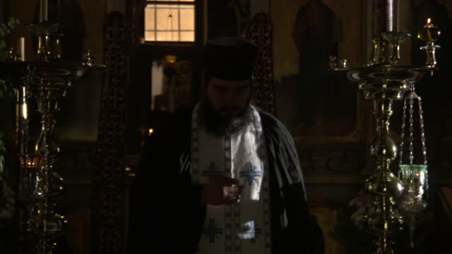 "a greek orthodox priest prays and performs the ""sign of the cross"" in a temple. - clergy stock videos & royalty-free footage"