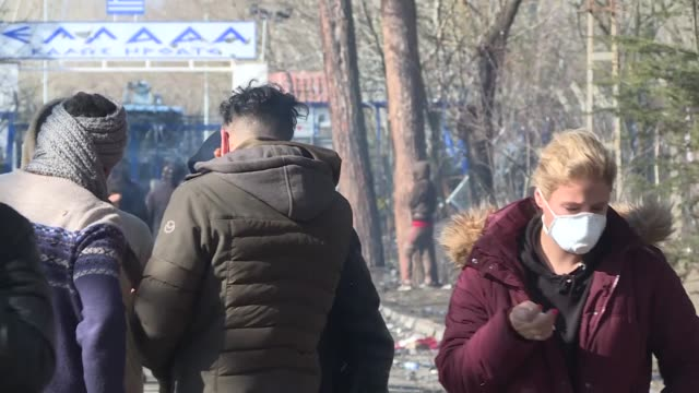 greek police fired teargas to push back hundreds of migrants gathered on its border with turkey on march 07, 2020. many asylum seekers were affected... - greece stock videos & royalty-free footage