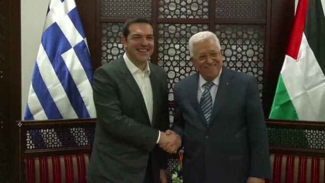 vídeos de stock, filmes e b-roll de greek prime minister alexis tsipras met on thursday with palestinian president mahmud abbas in ramallah on the second day of a visit to israel and... - ramallah
