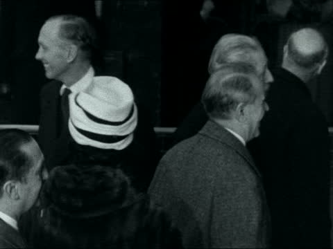 greek prime minister arrives at victoria station; england: london: victoria station: cts harold macmillan mp and lord home mp shakes hands with... - alec douglas home video stock e b–roll