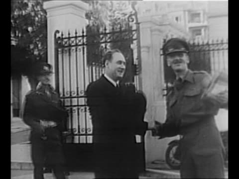 vidéos et rushes de greek prime minister georgios papandreou arrives at the hotel grande bretagne for a conference between british officials and elas insurgents during... - athens greece