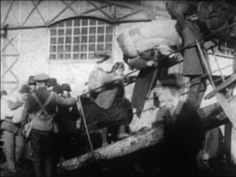 stockvideo's en b-roll-footage met greek refugees with packs on backs walking up gangplank fleeing from turkey / newsreel - turkije midden oosten