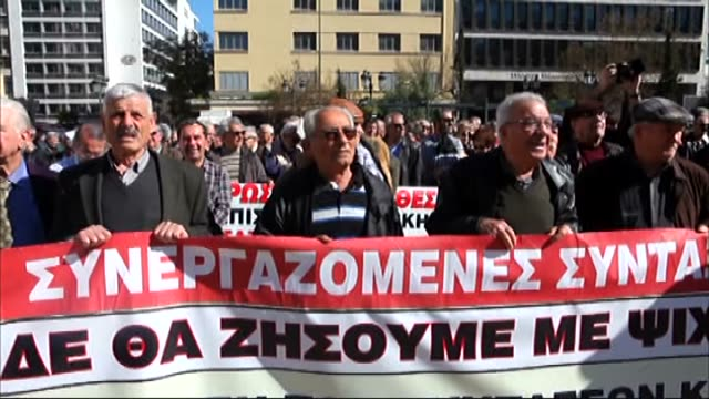 Greek retirees hold banners and shout slogans during a demonstration staged to protest pension cuts in central Athens on April 1 2015