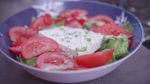 a greek salad with feta cheese for lunch on a sailboat boat. - cultura mediterranea video stock e b–roll