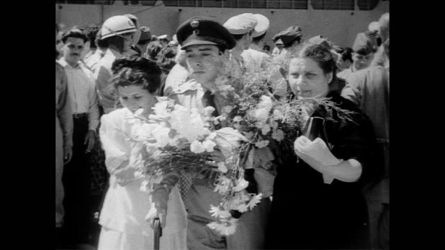 vídeos y material grabado en eventos de stock de / greek soldiers disembark at port of athens / soldiers on stretchers, others walking with nurses / soldier reunites with happy wife / king paul pins... - 1951