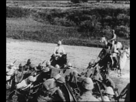 greek soldiers ford small stream during retreat in greco-turkish war / turkish soldiers and wagon train approach, pass camera / montage smoke and... - türkei stock-videos und b-roll-filmmaterial