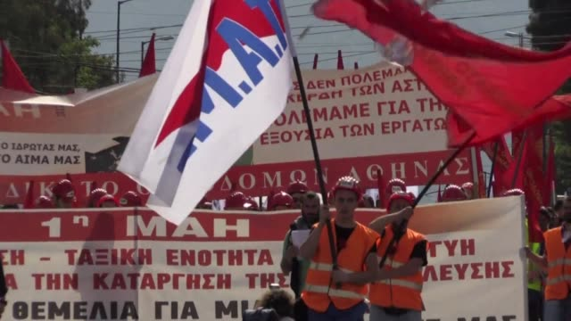 greek trade unions mark may day with a 24 hour nationwide strike and protests against looming new cuts demanded by the country's creditors in return... - grecia stato video stock e b–roll