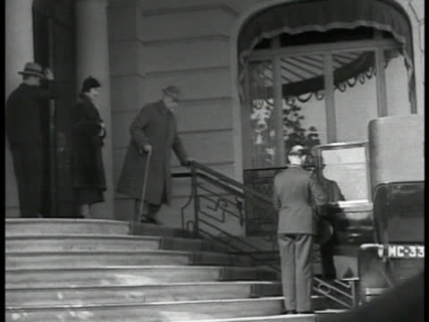 greek-russian arms trader & financier sir basil zaharoff in coat hat walking slowly w/ cane out home & down steps to chauffeur & rolls-royce car.... - 1935 stock videos & royalty-free footage
