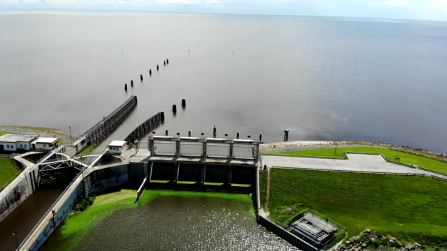 green algae blooms are seen at the port mayaca lock and dam on lake okeechobee on july 10 2018 in port mayaca florida gov rick scott has declared a... - florida us state stock videos and b-roll footage