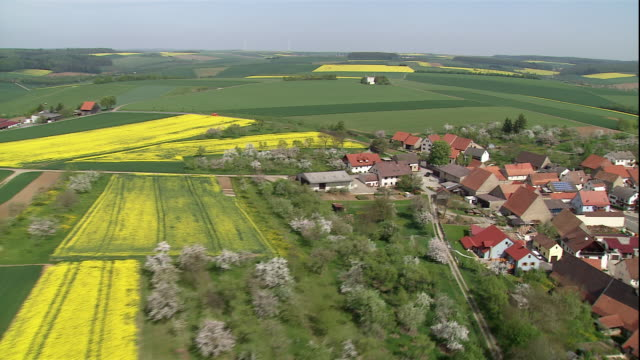 green and yellow fields surround a quaint village in germany. - baden württemberg stock videos & royalty-free footage