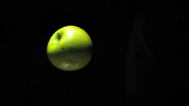green apple rotating in the air - apple fruit stock videos and b-roll footage