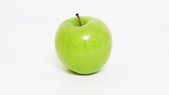 green apple - plain background stock videos & royalty-free footage
