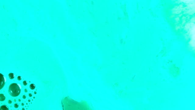 green aqua teal 3 vibrant bright paint and oil color swirls entropy - raw milk stock videos & royalty-free footage