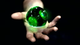 Green ball of plasma on hand. From NASA collection