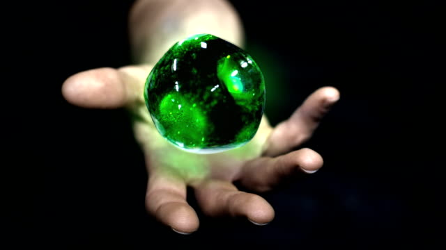 green ball of plasma on hand. from nasa collection - tesla coil stock videos and b-roll footage