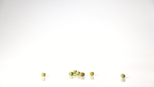 green bean seeds dancing captured with high speed sync - green bean stock videos & royalty-free footage
