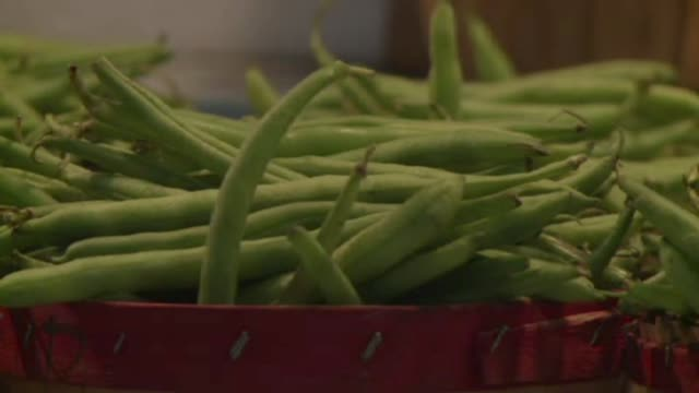 green beans at farmers' market on february 28 2012 in dallas texas - グリーンビーンズ点の映像素材/bロール