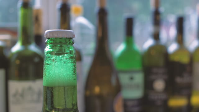 green beer bottle - cap stock videos and b-roll footage