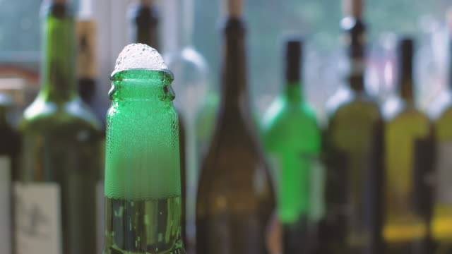 green beer bottle - cap stock videos & royalty-free footage