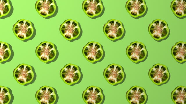green bell pepper spinning pattern on green background - green bell pepper stock videos & royalty-free footage