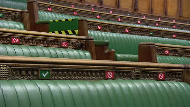 green benches in the house of commons set up for social distancing during coronavirus pandemic, labels saying where you can and cannot sit - label stock videos & royalty-free footage