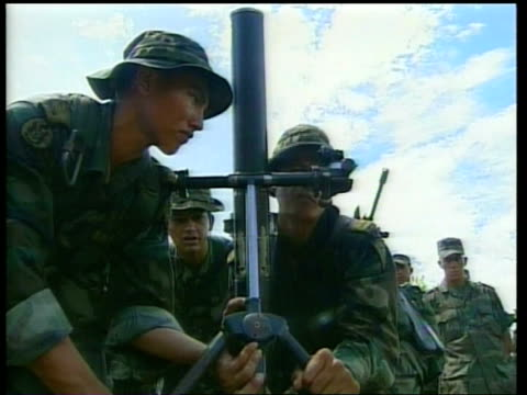 green berets training members of the colombian army as rocket launcher loaded and fired la ms two soldiers sighting rocket launcher as others stand... - colombia stock videos & royalty-free footage