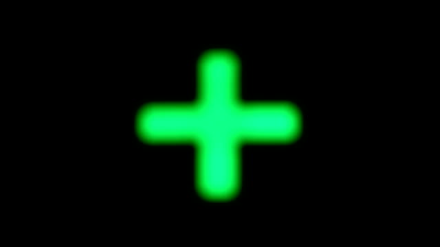 green blinking cross on a black background - religious cross stock videos & royalty-free footage