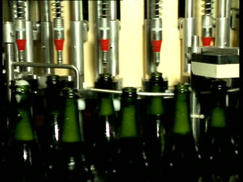 CU Green bottles being carried through bottling machine, Champagne