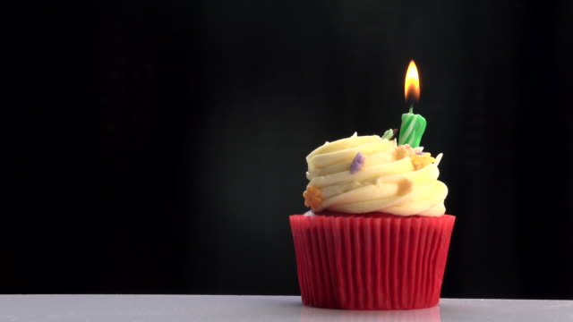 green candle on cup cake - cupcake stock videos & royalty-free footage