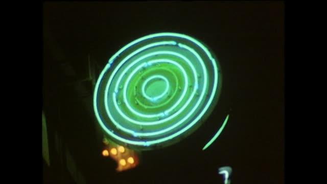cu green circular neon light flashing at night; 1975 - concentric stock videos & royalty-free footage