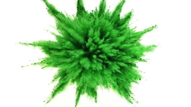 vídeos de stock, filmes e b-roll de green colored powder exploding towards camera in close up and super slow-motion, white background - verde descrição de cor