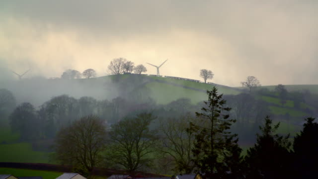 green countryside with wind turbines, wales - fog stock videos & royalty-free footage