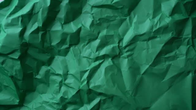 vídeos y material grabado en eventos de stock de papel rojo arrugado girando - cartón
