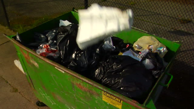 stockvideo's en b-roll-footage met green dumpster - afvalcontainer container