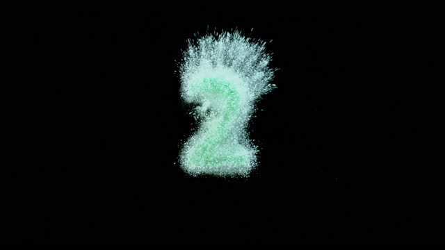 "slo mo ld green dust falling onto a black surface forming the number ""2"" - number 2 stock videos & royalty-free footage"