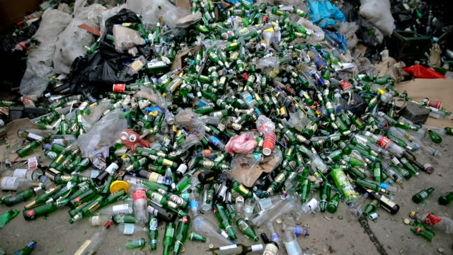 Green empty bottles for recycling - recovery of waste