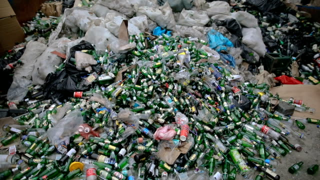 green empty bottles for recycling - recovery of waste - spazzatura video stock e b–roll