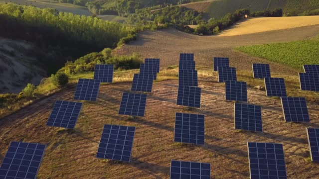 green energy field on hills in italy - solar panels - installing stock videos and b-roll footage